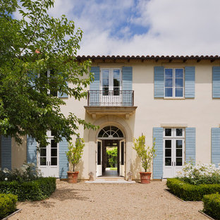Inspiration for a french country beige two-story stucco exterior home remodel in San Francisco with a tile roof