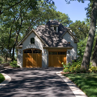 Inspiration for a mid-sized french country beige two-story stone exterior home remodel in Chicago with a hip roof
