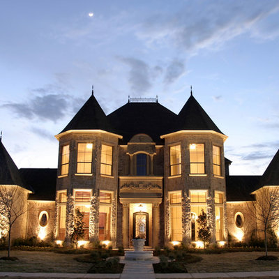 Inspiration for a large timeless beige two-story stone exterior home remodel in Dallas