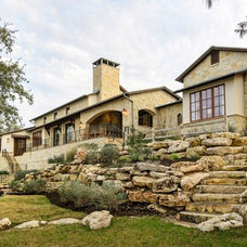 Mediterranean Exterior by SILVERTON CUSTOM HOMES