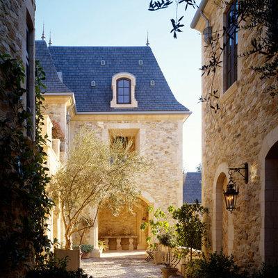 Elegant stone exterior home photo in Los Angeles
