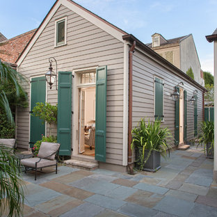 Inspiration for a timeless wood exterior home remodel in New Orleans
