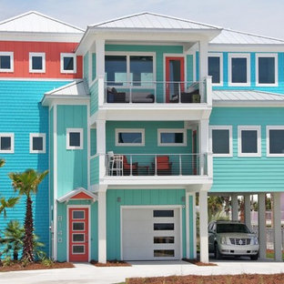 Coastal multicolored three-story mixed siding exterior home photo in Atlanta with a hip roof and a metal roof