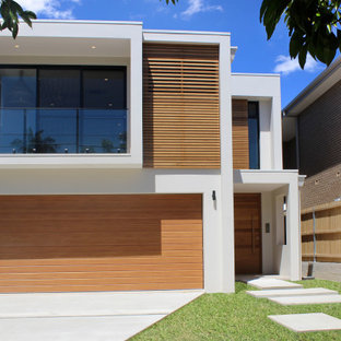 Large contemporary two-storey multi-coloured house exterior in Sydney with mixed siding and a flat roof.