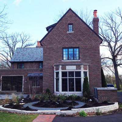Example of a mid-sized classic three-story brick house exterior design in Chicago