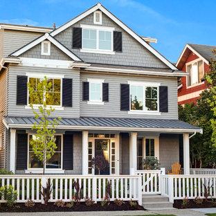 Inspiration for a large craftsman gray three-story wood gable roof remodel in Seattle