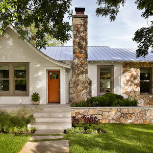 Small traditional one-story wood exterior home idea in Austin