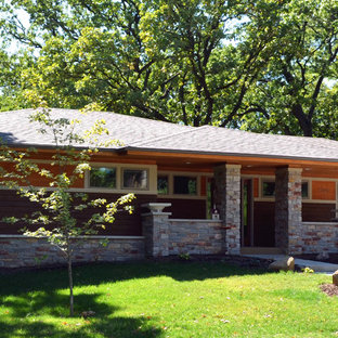 Exterior home photo in Milwaukee with a hip roof