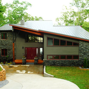 Large modern gray three-story mixed siding exterior home idea in New York with a shed roof