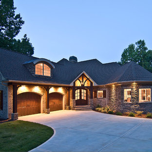 Inspiration for a mid-sized rustic beige one-story brick exterior home remodel in Charlotte with a shingle roof