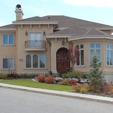 Mediterranean Exterior by Joe Carrick Design - Custom Home Design