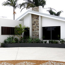 Midcentury Exterior by KTR Creations