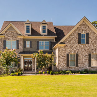 Photo of a traditional two-storey brick brown exterior in Atlanta with a gable roof.