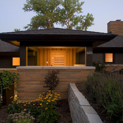 Inspiration for a large contemporary black one-story mixed siding exterior home remodel in Minneapolis with a hip roof and a shingle roof