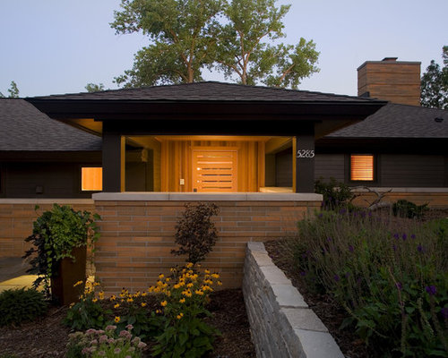 Inspiration for a large contemporary black one-story mixed siding exterior  home remodel in Minneapolis