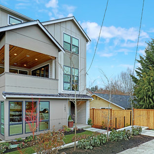 Inspiration for a large farmhouse gray three-story mixed siding house exterior remodel in Seattle with a shingle roof