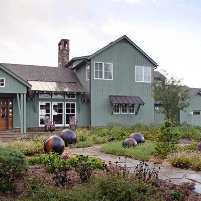 Farmhouse green exterior home photo in Omaha