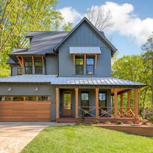 Country blue two-story mixed siding exterior home photo in Charlotte with a shingle roof