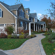 Traditional Exterior by Masters Touch Design Build