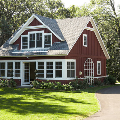 Inspiration for a country wood exterior home remodel in Minneapolis