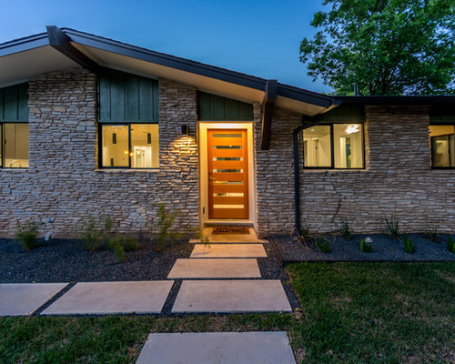 1960s beige one story stone gable roof idea in austin with a shingle roof