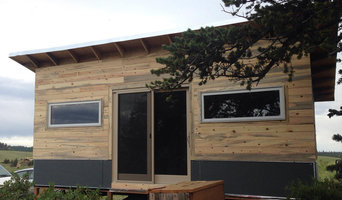Front facade with ribbon windows, hardy board siding, and beetle kill siding
