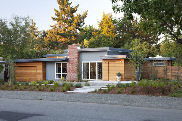 Midcentury Exterior by Klopf Architecture