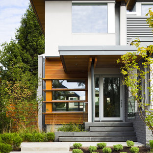 This is an example of a contemporary exterior in Vancouver with wood cladding.