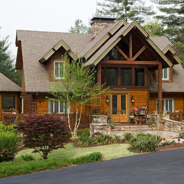 Front of Log and Timber Home with Inviting Front Porch
