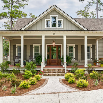 Example of a beach style gray two-story wood exterior home design in Charleston with a shingle roof