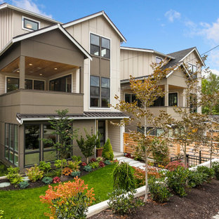 Country gray three-story mixed siding house exterior photo in Seattle with a shingle roof