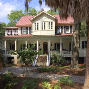 Example of a coastal wood exterior home design in Other