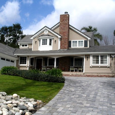 Traditional Exterior by Behr Construction Company