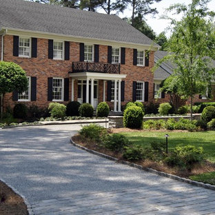 Large and red traditional brick detached house in Atlanta with three or more floors, a pitched roof and a shingle roof.
