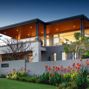 This is an example of a large and gey contemporary two floor house exterior in Perth with a flat roof.