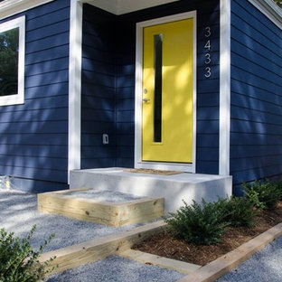 Inspiration for a small 1950s blue one-story wood house exterior remodel in Charlotte with a hip roof and a shingle roof