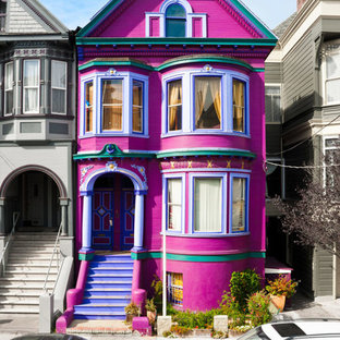 Inspiration for a mid-sized victorian pink three-story mixed siding exterior home remodel in Vancouver with a shingle roof