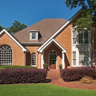 Elegant orange exterior home photo in Atlanta with a shingle roof