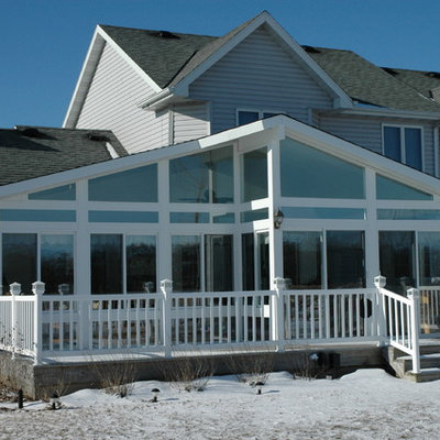 Inspiration for a large timeless white two-story wood exterior home remodel in Other with a shingle roof
