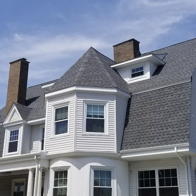 Mid-sized traditional white two-story vinyl house exterior idea in Providence with a gambrel roof and a shingle roof