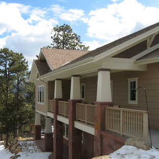 Large traditional multicolored split-level mixed siding exterior home idea in Denver with a clipped gable roof
