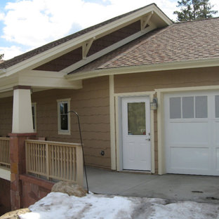 Large elegant multicolored split-level mixed siding exterior home photo in Denver with a clipped gable roof