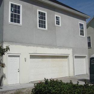 Ispirazione per la facciata di un appartamento ampio grigio classico a due piani