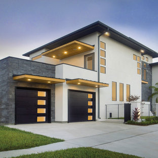 large minimalist white two story concrete flat roof photo in tampa - Exterior Modern Home Design