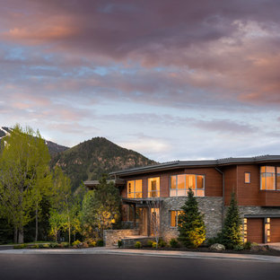 Example of a large mountain style brown three-story wood duplex exterior design in Salt Lake City
