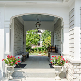 Inspiration for a large transitional gray two-story mixed siding house exterior remodel in Chicago with a clipped gable roof and a shingle roof