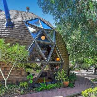 Example of an eclectic brown house exterior design in San Diego with a shingle roof