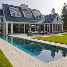 Contemporary Pool by Orren Pickell Building Group