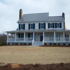 Farmhouse Exterior by Timber Creek Builders
