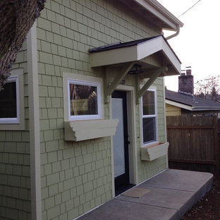 Example of a small arts and crafts two-story concrete fiberboard exterior home design in Portland